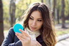 Girl admires itself Stock Photo