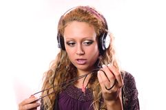 The girl admires with new ear-phones Stock Photography