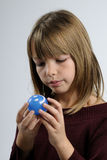 Girl admiring small ball Stock Image