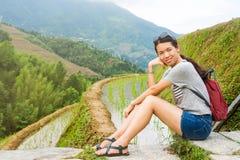 Girl admiring rice terrace scenery Royalty Free Stock Image
