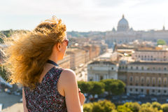 Girl admiring views of St. Peter's Basilica Royalty Free Stock Photo