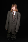 Girl in adult business suit Royalty Free Stock Photo