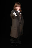 Girl in adult business suit Stock Image