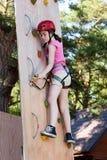 Girl in adventure park. Girl climbing in adventure park royalty free stock photos