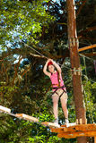 Girl in adventure park. Girl exercising in adventure park Royalty Free Stock Images