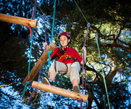 Girl in adventure park. Girl exercising in adventure park Stock Images