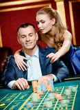 Girl advises gambler a safe bet Royalty Free Stock Images