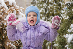 Girl afraid of jumping out of the snow-covered trees Royalty Free Stock Images