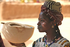 Girl in Africa. Fulani girl in Africa with a Calabas royalty free stock photos