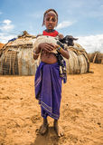 Girl from the African tribe Dasanesh holding a goat Royalty Free Stock Photos