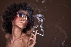 Girl with afro hair and a cigarette Stock Photos