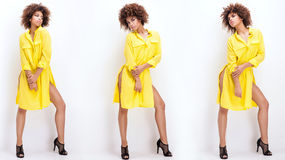 Girl with afro in yellow dress. Stock Photos