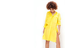 Girl with afro in yellow dress. Stock Photo