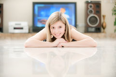 Girl against big TV Royalty Free Stock Image