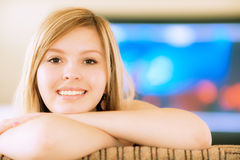 Girl against big TV Stock Photos
