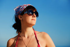 Girl against blue sky Stock Image