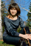 Girl against blue sky and birches Royalty Free Stock Photos