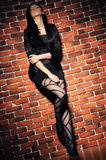 Girl against  brick wall Royalty Free Stock Photography