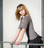 Girl against bright urban background.. Stock Photography