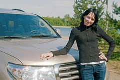 Girl against car Stock Image