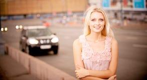 Girl against city prospectus Stock Photo