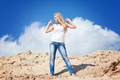 Girl against the dark blue sky Royalty Free Stock Photo