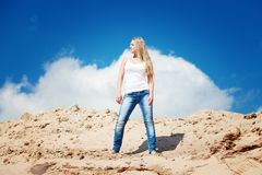 Girl against the dark blue sky Royalty Free Stock Image