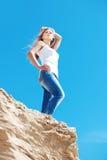 Girl against the dark blue sky Stock Photos