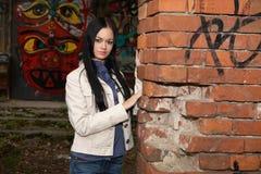 The girl  against graffiti Stock Image