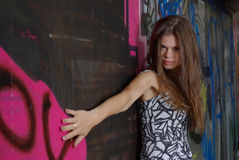 Girl against graffiti Stock Image