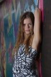 Girl against graffiti Stock Image