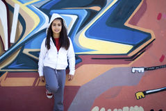 Girl against graffiti wall Royalty Free Stock Image