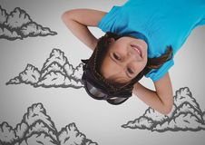 Girl against grey background with goggles upside down and cloud illustrations Royalty Free Stock Photos