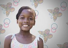 Girl against grey background smiling and butterfly patterns. Digital composite of Girl against grey background smiling and butterfly patterns stock photos