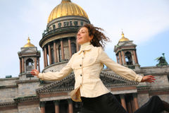 Girl against the Isaakievsky cathedral Royalty Free Stock Photography