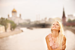 Girl against Moscow Kremlin and river Royalty Free Stock Images