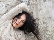 Girl against old concrete wall stock image