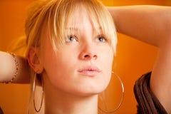 Girl against orange wall Stock Photo