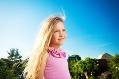 Girl against a sky Stock Photos