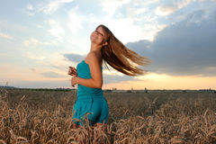 Girl  against sunset sky Royalty Free Stock Photo