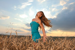 Girl against sunset sky Stock Photography