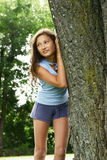 Girl against a tree Stock Photo