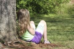 Girl Against Tree Royalty Free Stock Photos