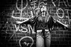 Girl Against Wall Stock Photos