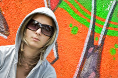 Girl against wall with graffiti Royalty Free Stock Photo