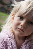 Girl age 2 or 3 looking concerned or worried Royalty Free Stock Image