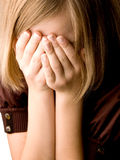Girl at age of thirteen covers her face. With her hands closeup Stock Photos
