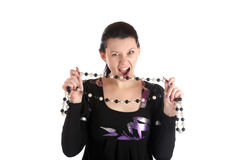 The girl with an aggressive look holds  beads Royalty Free Stock Image