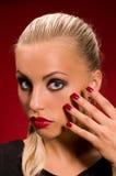 Girl with aggressive makeup Stock Photos