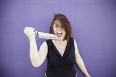 Girl aggressive razor Royalty Free Stock Photos